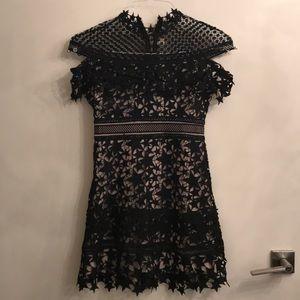 Dresses & Skirts - Black star lace dress